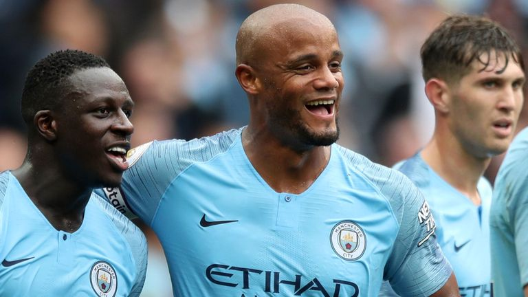 Manchester City's footballers looking happy.