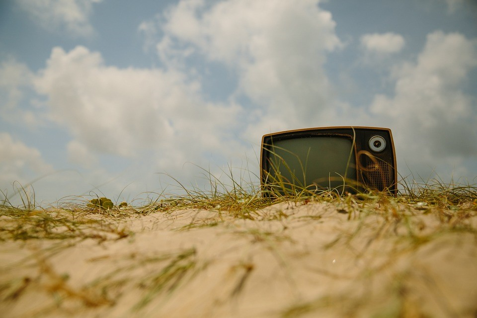 A TV set in the sand.